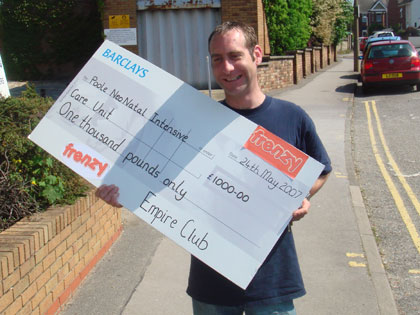 Cheeky Scott, Frenzy resident DJ walks in with the cheque